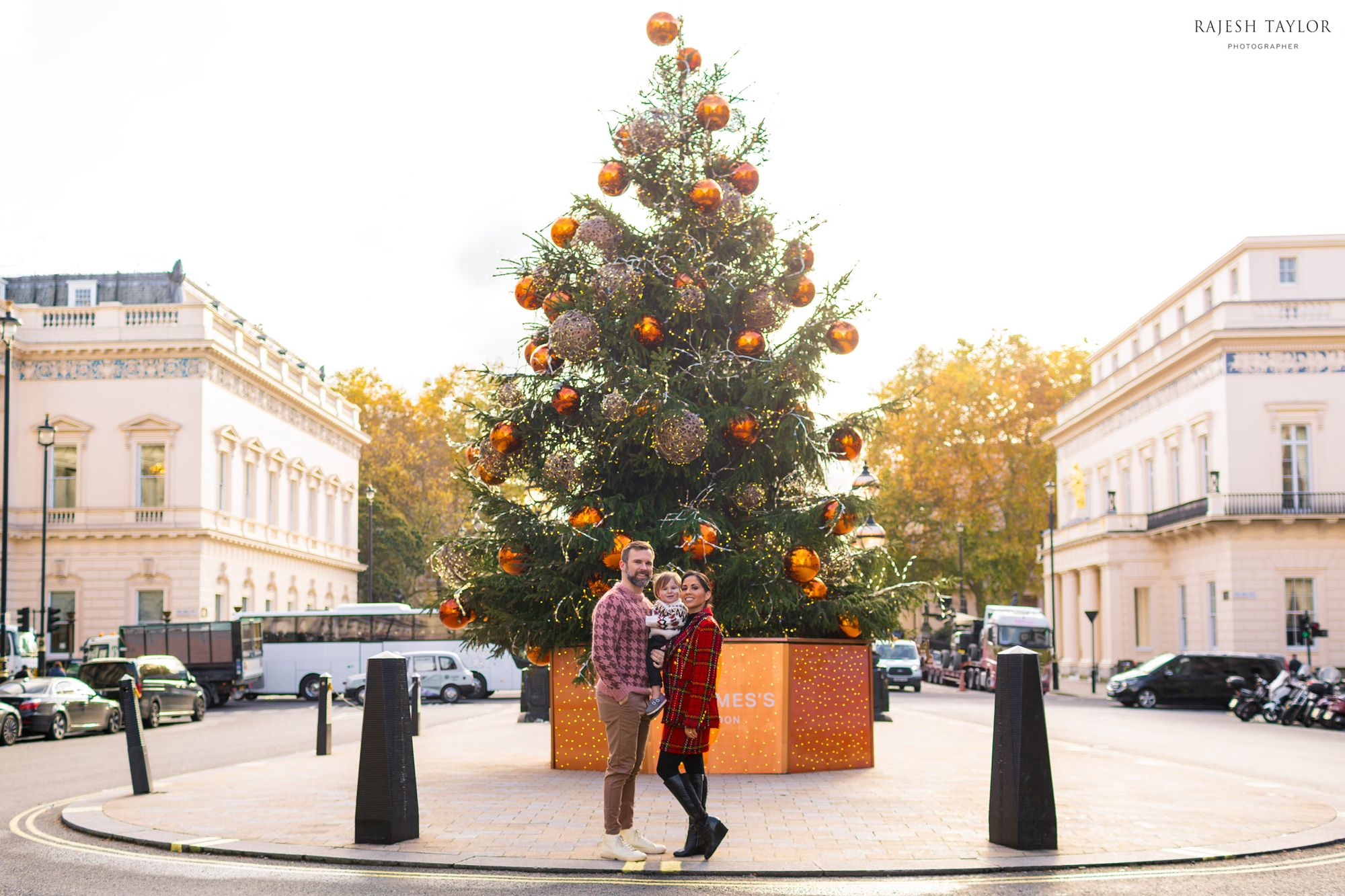 The St James's Christmas Tree on Waterloo Place with The Snelling Family (L) Institute of Directors (formerly the United Service Cub) and (R) The Athenaeum in the distance: © Rajesh Taylor