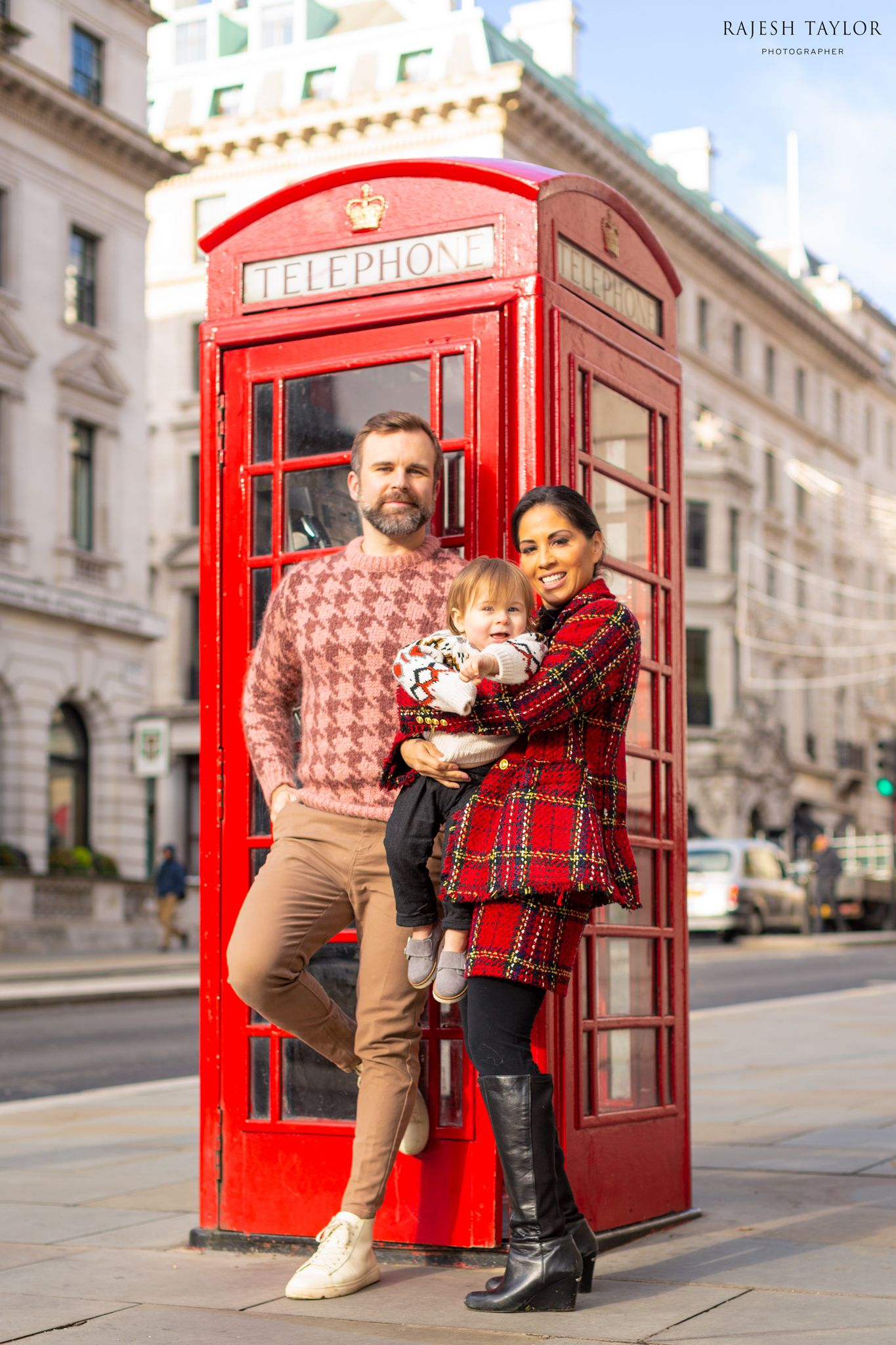 The Snelling Family with 12 Waterloo Place, original home of The Athenaeum Club is the building directly the red phone box © Rajesh Taylor